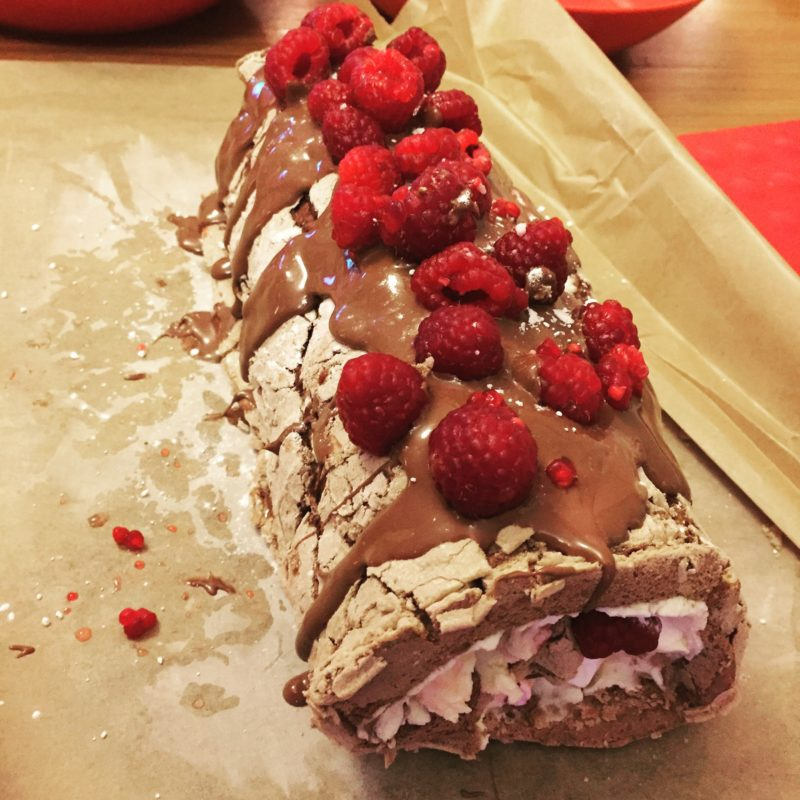 chocolate meringue roulade with raspberries