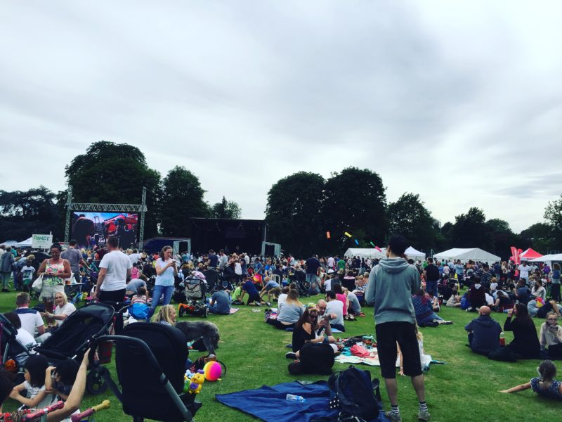large crowd for wokings party in the park