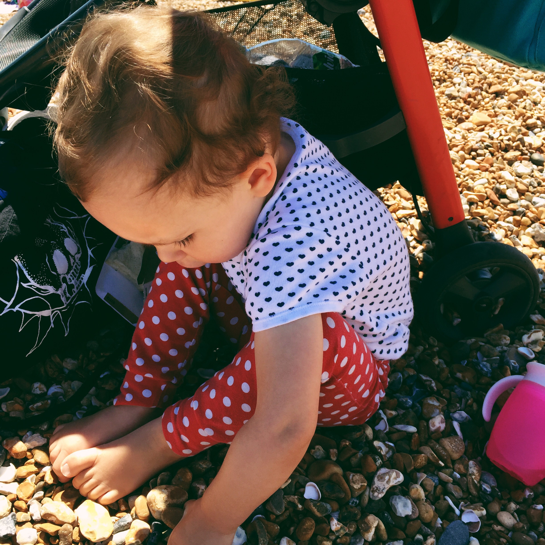 toddler girl on the pebble beach