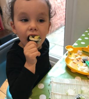 toddler girl eating homemade sushi