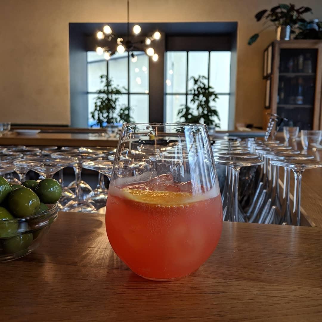 orange drink in glass on counter in cincin restaurant