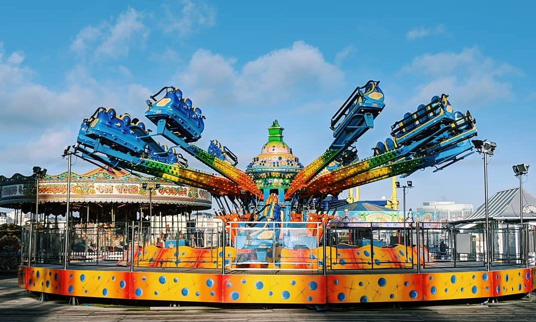 blue sky fun fair ride on brighton pier