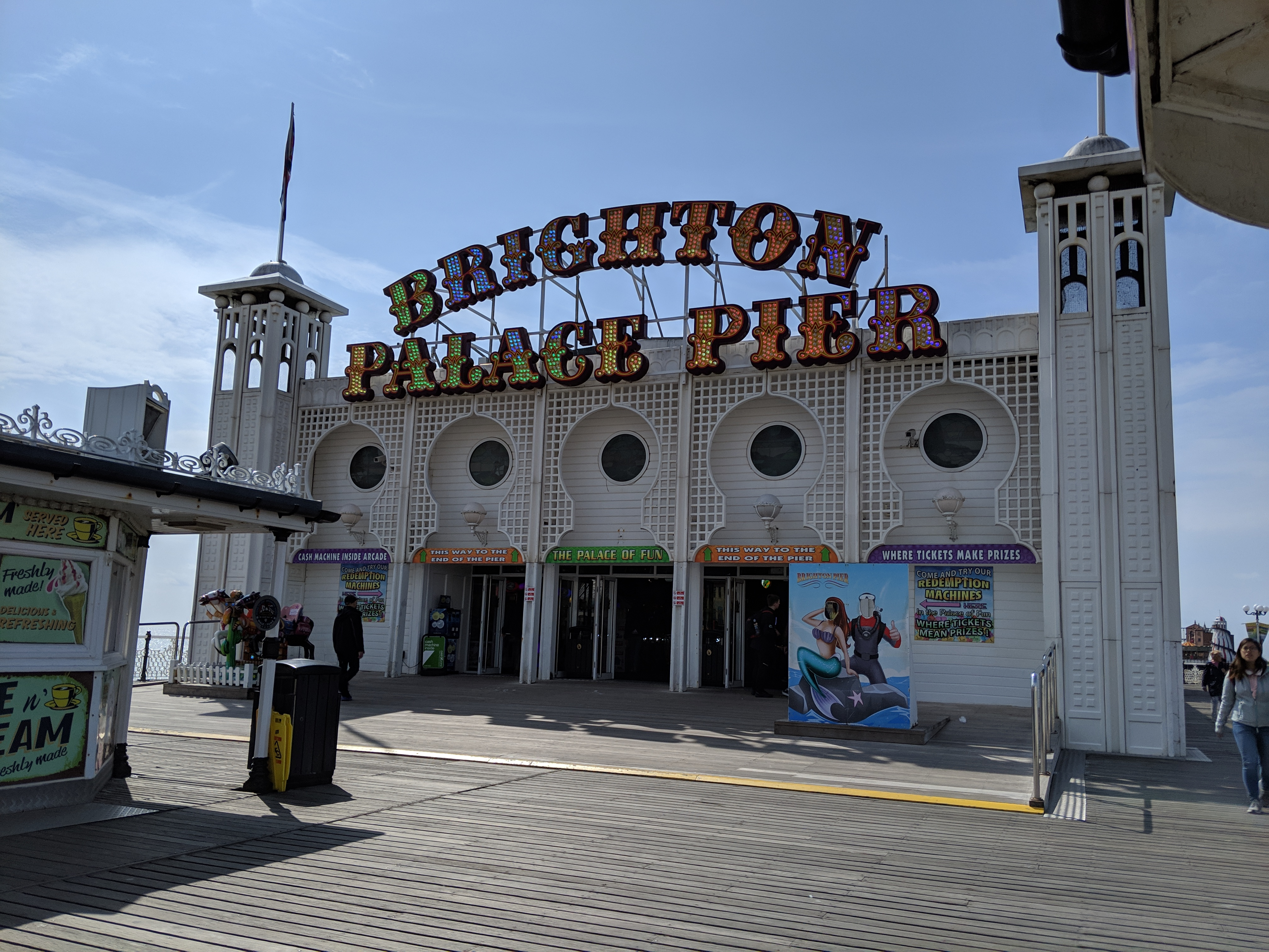 brighton palace pier sign in the sun may 2019
